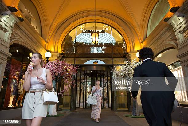 Visitors walk through the entrance to the GUM department store in Moscow Russia on Thursday May 16 2013 Russia's government is split over charging...