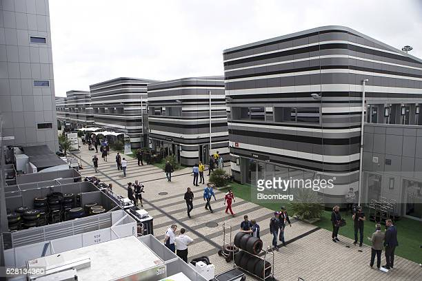 Visitors walk through the Formula One paddock during the Russian Grand Prix at the Sochi Autodrome in Sochi Russia on Sunday May 1 2016 The ruble...
