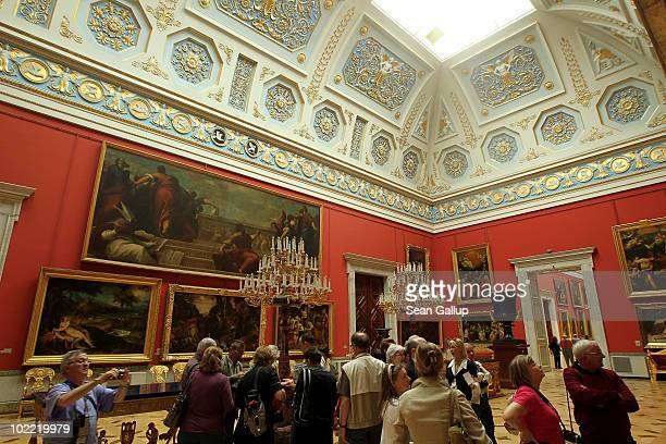 Visitors walk through the Italian Skylight Halls at the State Hermitage museum on June 19 2010 in St Petersburg Russia The State Hermitage founded in...