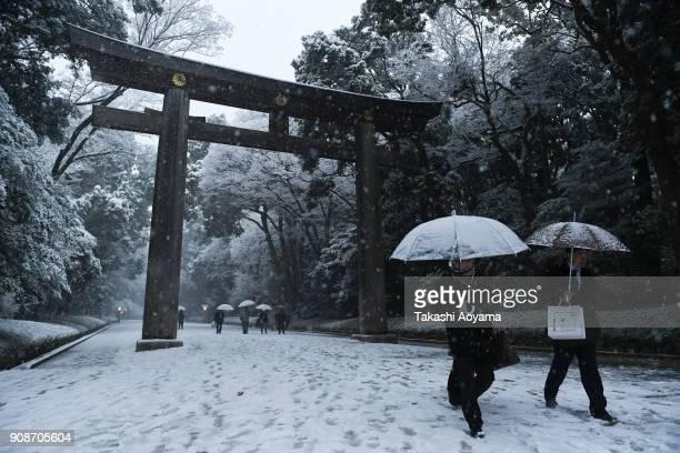 Visitors walk through the Meiji Jingu Shrine on January 22 2018 in Tokyo Japan The Japan Meteorological Agency has issued the heavy snow warning in...