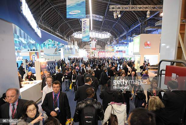 Visitors walk through the Mobile World Congress venue in Barcelona Spain on Tuesday Feb 16 2010 Leading mobile executives from across the globe...