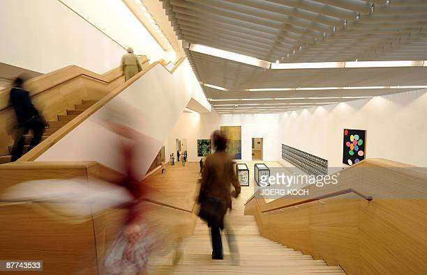 Visitors walk through the Museum Brandhorst in Munich southern Germany on May 18 2009 The new museum which is set to open to the public on on May 21...