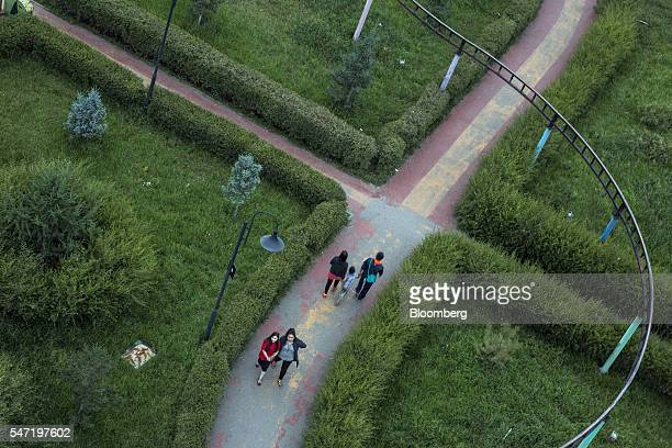 Visitors walk through the National Amusement Park known as the Children's Park in Ulaanbaatar Mongolia on Wednesday July 13 2016 The nation's growth...