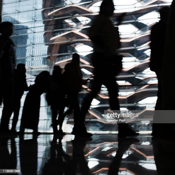 Visitors walk through the newly opened luxury shopping mall at the Hudson Yards development on the West Side of Midtown Manhattan on March 18 2019 in...
