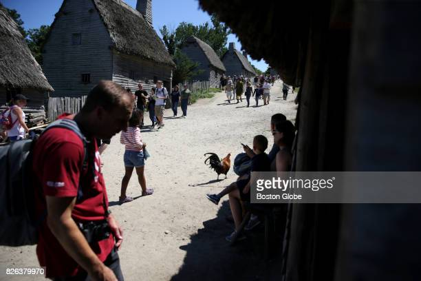 Visitors walk through the Plimoth Plantation 17thCentury English village in Plymouth MA on Jul 26 2017