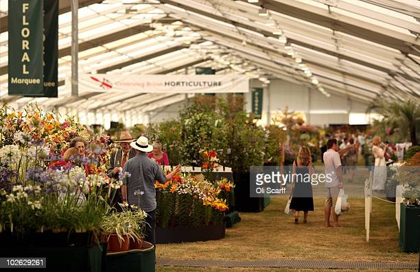 Visitors walk through the RHS Floral Marquee on the press preview day of the Hampton Court Palace Flower Show on July 5 2010 in London England The...