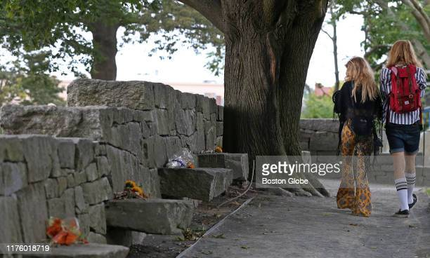 Visitors walk through the Salem Witch Memorial in Salem MA on Sep 26 2019 The legacy of the Salem witch trials is complicated During October tourists...