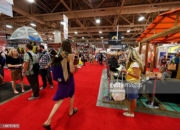 Visitors walk through the Salt Palace Convention Center during the Outdoor Retailer Summer Market show in Salt Lake City Utah US on Thursday Aug 2...