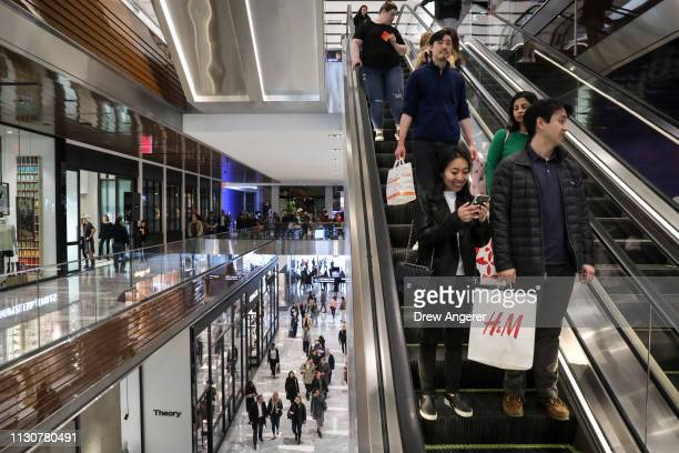 Visitors walk through 'The Shops' during the grand opening of phase one of the Hudson Yards development on the West Side of Midtown Manhattan March...