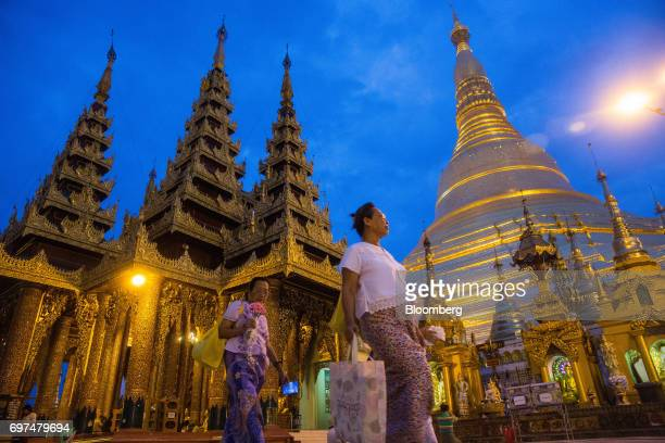 Visitors walk through the Shwedagon Pagoda in Yangon Myanmar on Monday June 12 2017 When the country opened to the outside world in 2011 after...