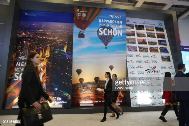 Visitors walk through the Turkey hall at the ITB international tourism trade fair on March 7 2018 in Berlin Germany This year's ITB includes 190...