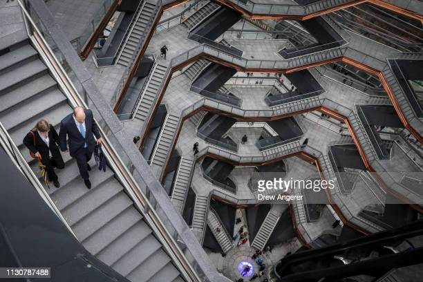 Visitors walk through 'The Vessel' a public art structure consisting of 155 flights of stairs on the opening day for phase one of the Hudson Yards...