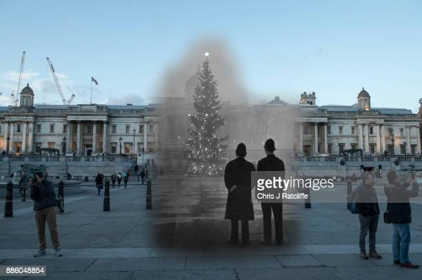 In this digital composite image a comparison has been made of London at Trafalgar Square in 1948 and Modern Day 2017 at Christmas time LONDON ENGLAND...