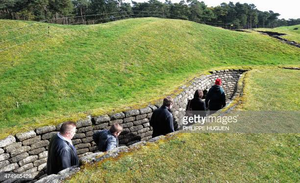 Visitors walk through trenches at the historic site of the Crete de Vimy where Canadian troops took up positions during World War I in Vimy on...