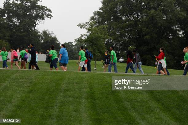 Visitors walk to the grave of President John F Kennedy at Arlington National Cemetery in Arlington Virginia May 29 2017 Today would have been...