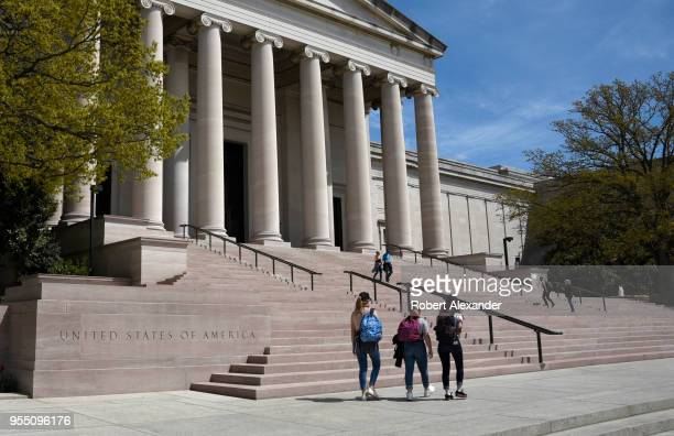 Visitors walk toward the National Gallery of Art in Washington, D.C., located on the National Mall.