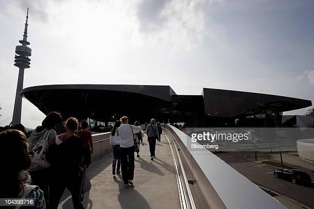 Visitors walk towards the BMW World customer center in Munich Germany on Friday Sept 3 2010 Bayerische Motoren Werke AG the world's largest maker of...