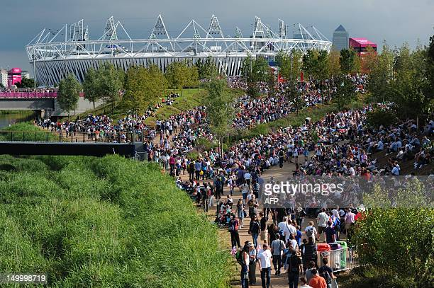 Visitors walk towards The Olympic Stadium in the London 2012 Olympic Park in east London on August 8 during The 2012 London Olympic Games AFP PHOTO /...