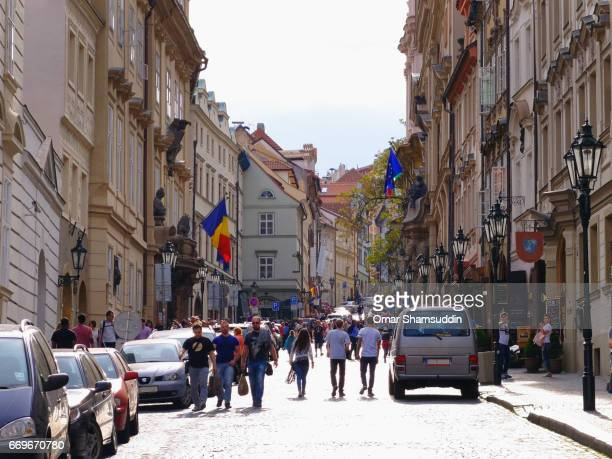 visitors walking at the old town square, prague, czech republic. - omar shamsuddin stock pictures, royalty-free photos & images