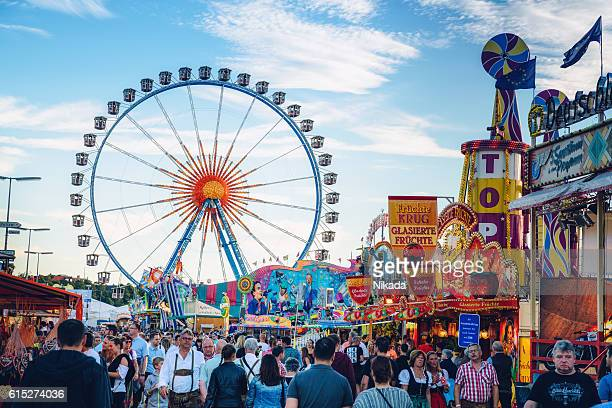 Visitors Walking Through Oktoberfest Fairgrounds, Munich, Germany