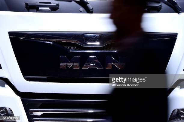 A visitors walks by a MAN Truck during the company's annual general shareholders meeting on May 10 2017 in Hanover Germany While the company has...