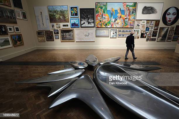 Visitors walks past a piece of work entitled 'Kloris' by artist Dame Zaha Hadid RA during a press preview of the Royal Academy's 'Summer Exhibition'...