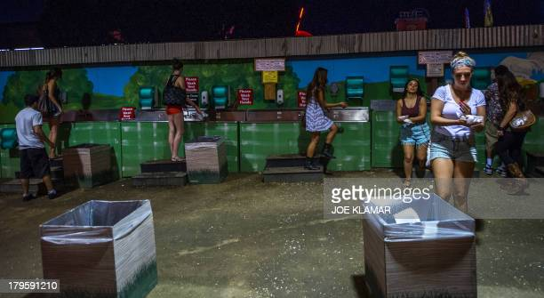 Visitors wash their hands at petting zoo during the Los Angeles County Fair 2013 in Pomona, California on September 4, 2013. The LA County Fair...