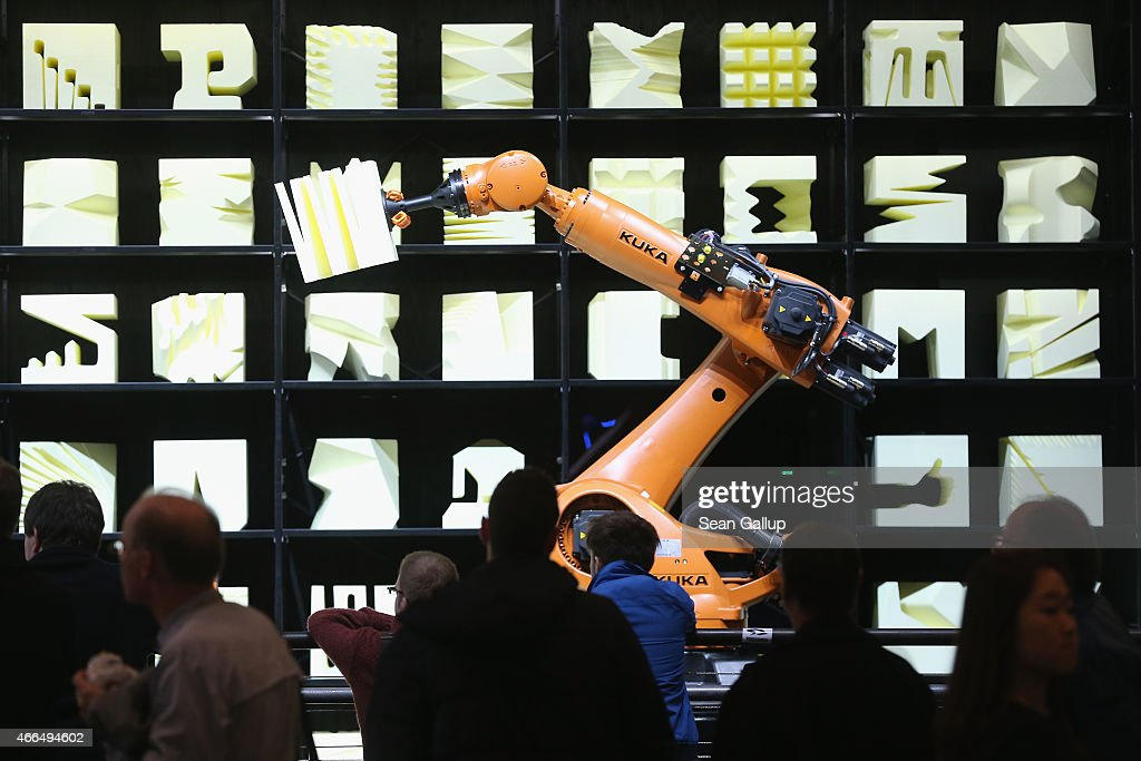 Visitors watch a Kuka robot perform precise movements as part of the Robochop interactive robot installation at the 2015 CeBIT technology trade fair on March 16, 2015 in Hanover, Germany. China is this year's CeBIT partner. CeBIT is the world's largest tech fair and will be open from March 16 through March 20.
