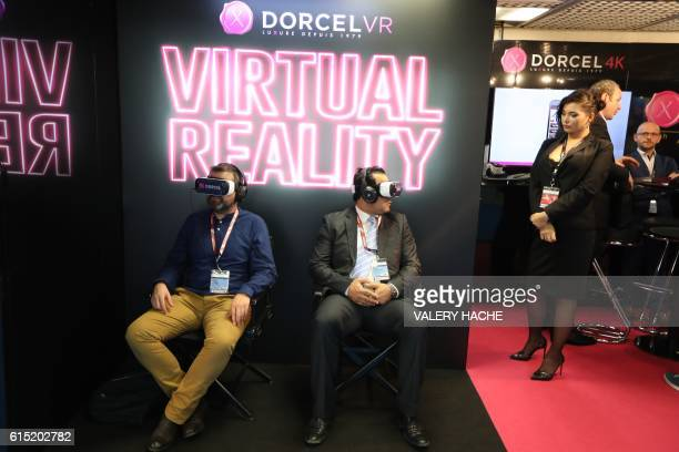 Visitors watch a Marc Dorcel production's erotic film in virtual reality during the world's entertainment content market on October 17 2016 in Cannes...