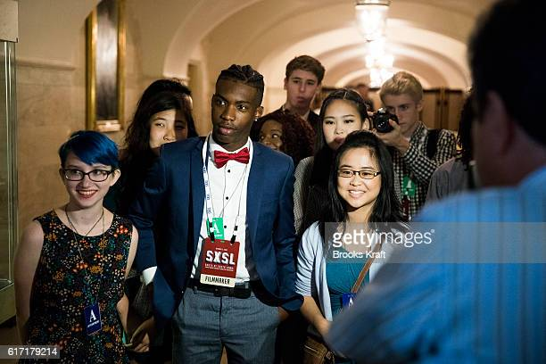 Visitors watch a musical performance inside the White House during the 'South By South Lawn' SXSL festival on October 3 2016 in Washington DC The...