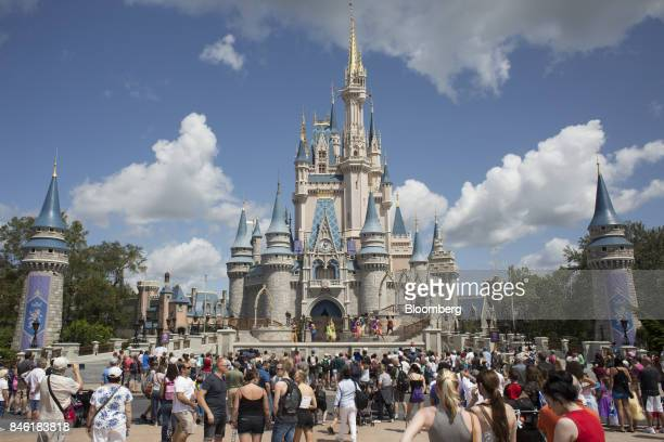 Visitors watch a performance at the Cinderella Castle at the Walt Disney Co Magic Kingdom park in Orlando Florida US on Tuesday Sept 12 2017 The Walt...