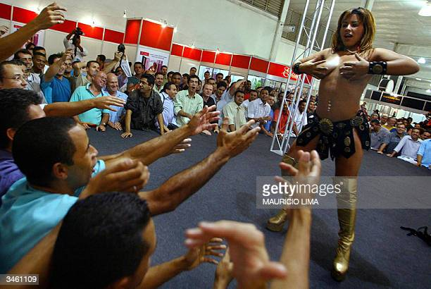 Visitors watch a striptease show during Erotika Fair in Sao Paulo Brazil late 22 April 2004 The event the biggest of its kind in Latin America and...