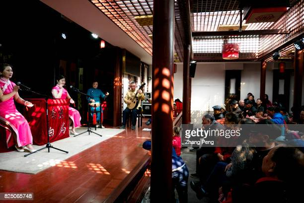Visitors watch a traditional local opera called 'Baiju' in the residence of Ganxi family Baiju is performed in local dialect and involves both...