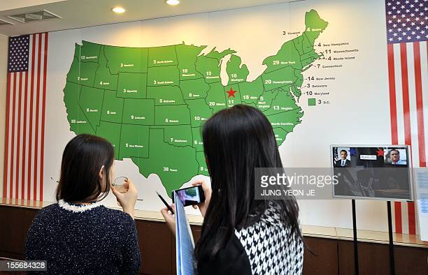 Visitors watch a US map for election returns during a '2012 US Election Watch' event organized by the US embassy in Seoul on November 7 2012 Barack...