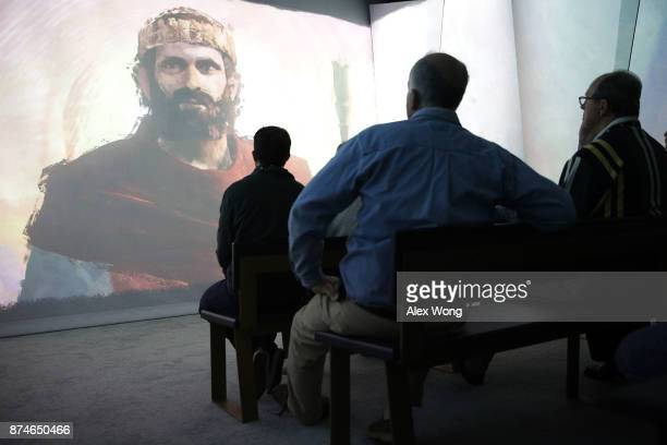 Visitors watch an animation film about King David as they go through an exhibit on the Old Testament at Museum of the Bible November 15 2017 in...