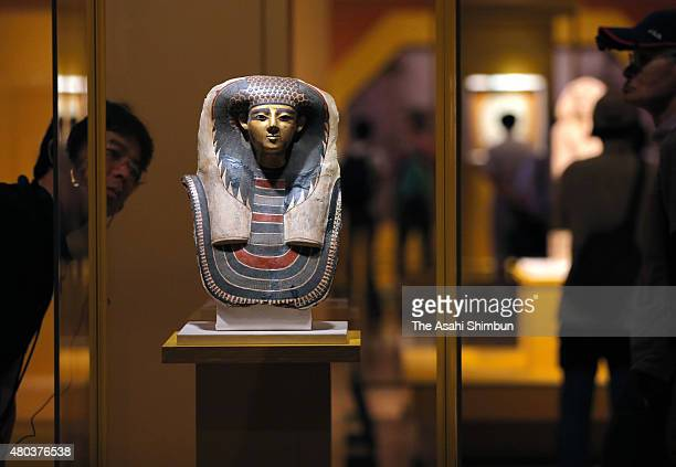 Visitors watch artworks as the 'Cleopatra and the Queens of Egypt' at Tokyo National Museum on July 11 2015 in Tokyo Japan The special exhibition...