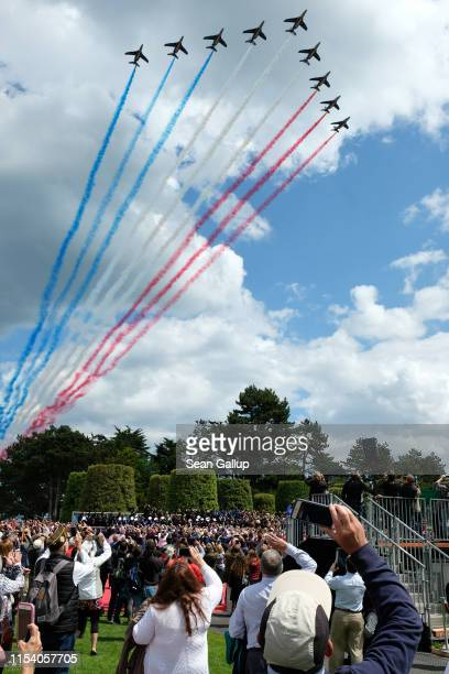 Visitors watch as French jets trail the colors of the French flags at the main ceremony to mark the 75th anniversary of the World War II Allied DDay...