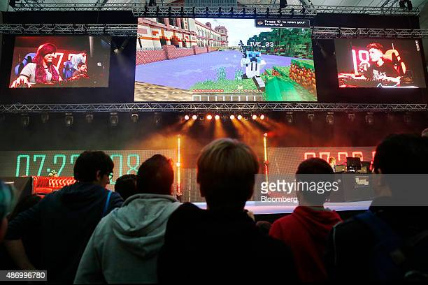Visitors watch as professional gamers and members of the audience compete at Minecraft on the main stage at the Legends of Gaming Live event in...