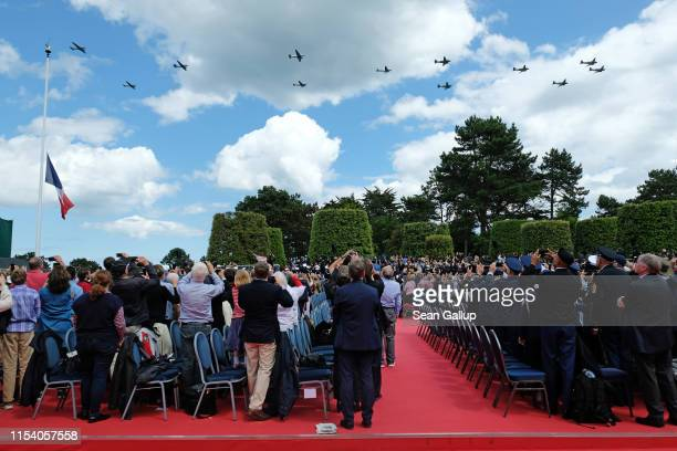 Visitors watch as World War IIera C47 airplanes do a flyover at the main ceremony to mark the 75th anniversary of the World War II Allied DDay...