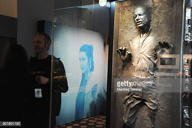 Visitors watch at a sculpture of Han Solo from the film 'Star Wars' is on display in the 'STAR WARS Identities' exhibition opening party at MAK on...