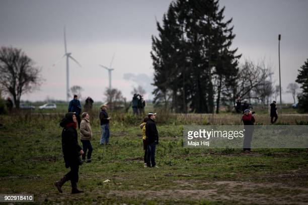 Visitors watch demolition of Saint Lambertus church on January 9 2018 in Immerath Germany The village of Immerath will be completely razed in order...