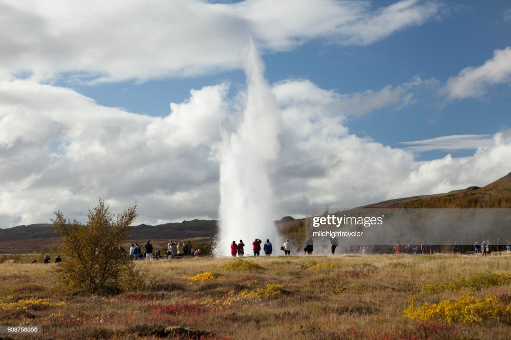 Visitors watch erupting Geysir or geyser southwest Iceland Reykholt : Stock Photo