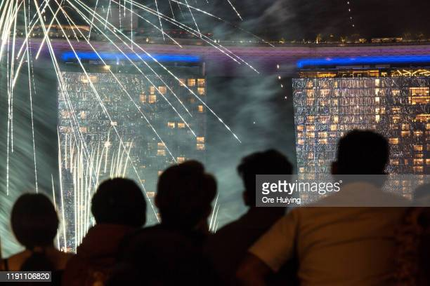 Visitors watch fireworks display at Marina Bay as Singapore count down to New Year 2020 on December 31 2019 in Singapore