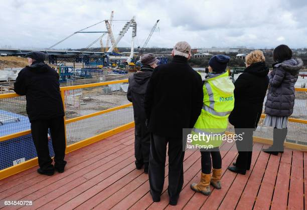 Visitors watch from a viewing platform as the final 100 metre centrepiece of Sunderland's new River Wear crossing is lifted into place on February 10...