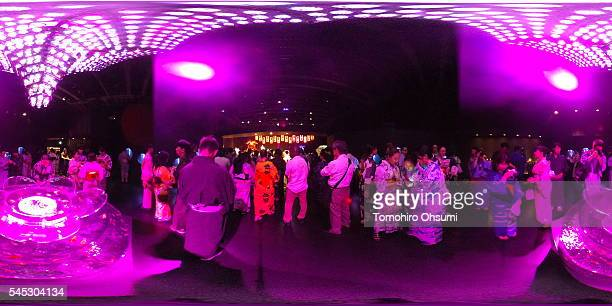 Visitors watch goldfish in tanks at the Art Aquarium 2016 exhibition at the Nihonbashi Mitsui Hall on July 7 2016 in Tokyo Japan At the exhibition...