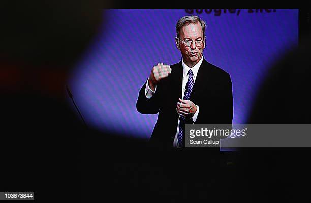 Visitors watch Google Chairman and CEO Eric Schmidt deliver the closing keynote speech on a television at the 2010 IFA technology trade fair at Messe...