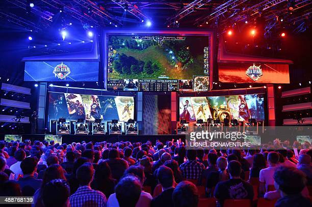 Visitors watch international teams play during the tournament of the computer game 'League of Legends' on May 8 2014 in Paris Launched late in 2009...
