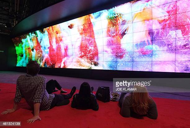 Visitors watch LG's World's Largest 3D Video Wall during the 2014 International CES at the Las Vegas Convention Center on January 7 2014 in Las Vegas...