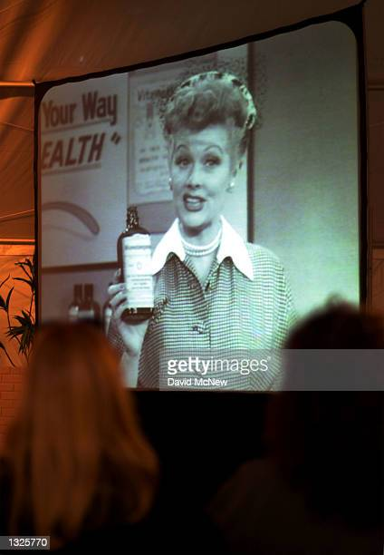 """Visitors watch Lucille Ball''s performance of her """"Vitameatagamin"""" skit during an exhibition celebrating the 50th anniversary of the """"I Love Lucy""""..."""