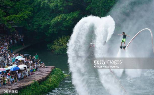 BEIJING Visitors watch performance at a theme park in Shenzhen City of south China's Guangdong Province Oct 4 2017 China is slated to become world's...
